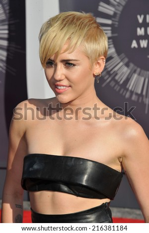 LOS ANGELES, CA - AUGUST 24, 2014: Miley Cyrus at the 2014 MTV Video Music Awards at the Forum, Los Angeles.  - stock photo