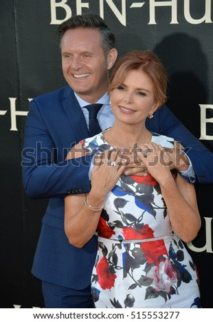 "LOS ANGELES, CA. August 16, 2016: Producer Mark Burnett & wife actress Roma Downey at the Los Angeles premiere of ""Ben-Hur"" at the TCL Chinese Theatre, Hollywood."