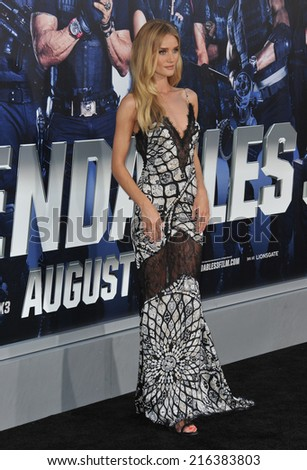 "LOS ANGELES, CA - AUGUST 11, 2014: Rosie Huntington-Whiteley at the Los Angeles premiere of ""The Expendables 3"" at the TCL Chinese Theatre, Hollywood."