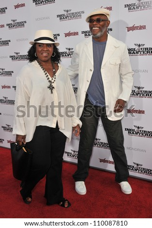 """LOS ANGELES, CA - AUGUST 10, 2009: Samuel L. Jackson & wife at the Los Angeles premiere of his new movie """"Inglourious Basterds"""" at the Grauman's Chinese Theatre, Hollywood. - stock photo"""