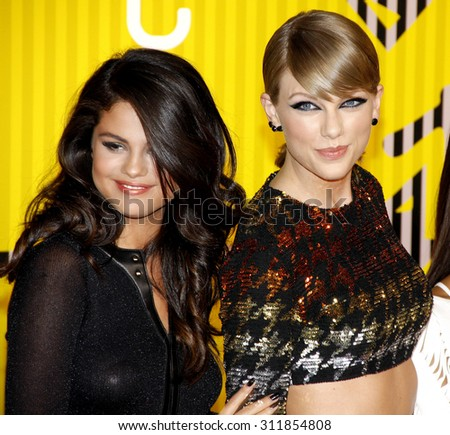 LOS ANGELES, CA - AUGUST 30, 2015: Selena Gomez and Taylor Swift at the 2015 MTV Video Music Awards held at the Microsoft Theater in Los Angeles, USA on August 39, 2015. - stock photo