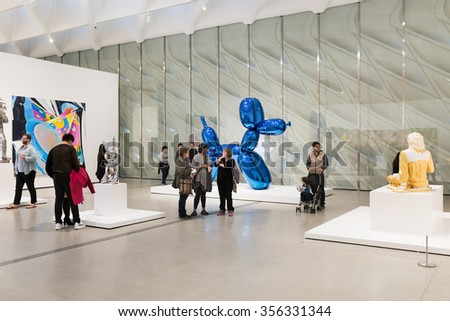 LOS ANGELES, CA - DEC. 29, 2015: The Broad Museums interior with Jeff Koons Balloon Dog (Blue) and Michael Jackson and Bubbles, is a contemporary art museum in Downtown Los Angeles. - stock photo