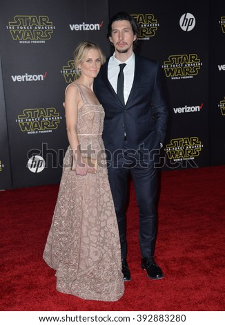 """LOS ANGELES, CA - DECEMBER 14, 2015: Actor Adam Driver & wife Joanne Tucker at the world premiere of """"Star Wars: The Force Awakens"""" on Hollywood Boulevard - stock photo"""