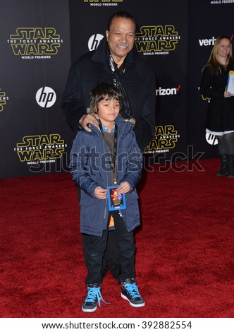"""LOS ANGELES, CA - DECEMBER 14, 2015: Actor Billy Dee Williams & grandson at the world premiere of """"Star Wars: The Force Awakens"""" on Hollywood Boulevard - stock photo"""