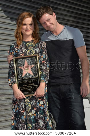 LOS ANGELES, CA - DECEMBER 3, 2015: Actress Amy Poehler & brother Greg Poehler on Hollywood Boulevard where she was honored with the 2,566th star on the Hollywood Walk of Fame.  - stock photo