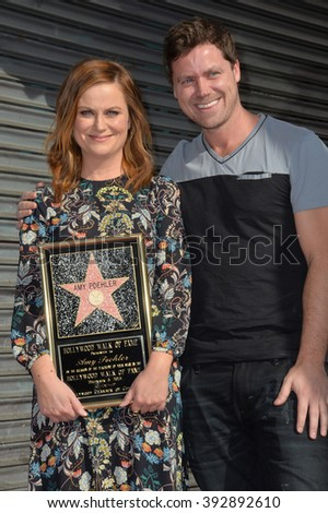 LOS ANGELES, CA - DECEMBER 3, 2015: Actress Amy Poehler & brother Greg Poehler on Hollywood Boulevard where she was honored with the 2,566th star on the Hollywood Walk of Fame - stock photo