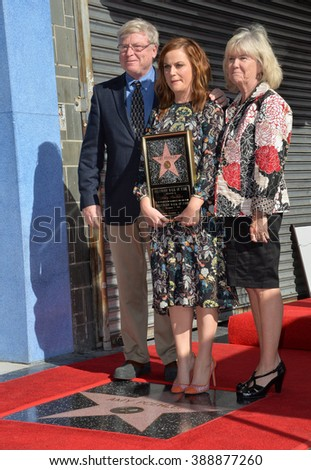 LOS ANGELES, CA - DECEMBER 3, 2015: Actress Amy Poehler & parents William Poehler & Eileen Poehler on Hollywood Boulevard where she was honored with the 2,566th star on the Hollywood Walk of Fame.  - stock photo