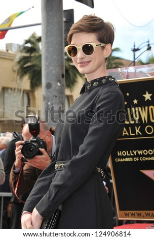 LOS ANGELES, CA - DECEMBER 13, 2012: Actress Anne Hathaway on Hollywood Blvd where actor Hugh Jackman was honored with the 2,487th star on the Hollywood Walk of Fame. - stock photo