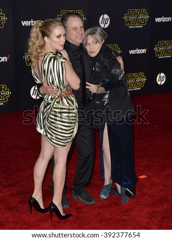 """LOS ANGELES, CA - DECEMBER 14, 2015: Actress Carrie Fisher & daughter Billie Lourd & brother Todd Fisher at the world premiere of """"Star Wars: The Force Awakens"""" on Hollywood Boulevard - stock photo"""