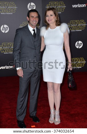 "LOS ANGELES, CA - DECEMBER 14, 2015: Actress Geena Davis & husband Dr. Reza Jarrahy at the world premiere of ""Star Wars: The Force Awakens"" on Hollywood Boulevard. Picture: Paul Smith / Featureflash - stock photo"
