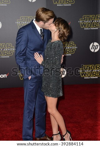 """LOS ANGELES, CA - DECEMBER 14, 2015: Actress Sarah Hyland & actor boyfriend Dominic Sherwood at the world premiere of """"Star Wars: The Force Awakens"""" on Hollywood Boulevard - stock photo"""