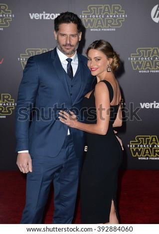 "LOS ANGELES, CA - DECEMBER 14, 2015: Actress Sofia Vergara & husband Joe Manganiello at the world premiere of ""Star Wars: The Force Awakens"" on Hollywood Boulevard - stock photo"