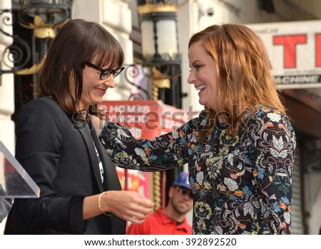LOS ANGELES, CA - DECEMBER 3, 2015: Actresses Amy Poehler & Rashida Jones on Hollywood Boulevard where Poehler was honored with the 2,566th star on the Hollywood Walk of Fame - stock photo