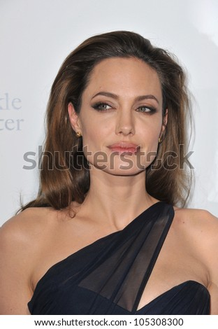 "LOS ANGELES, CA - DECEMBER 8, 2011: Angelina Jolie at the Los Angeles premiere of her new movie ""In The Land of Blood and Honey"" at the ArcLight Theatre, Hollywood. December 8, 2011  Los Angeles, CA - stock photo"