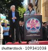 LOS ANGELES, CA - DECEMBER 18, 2009: Director James Cameron with actress Sigourney Weaver on Hollywood Boulevard where Cameron was honored with the 2,396th star on the Hollywood Walk of Fame. - stock photo