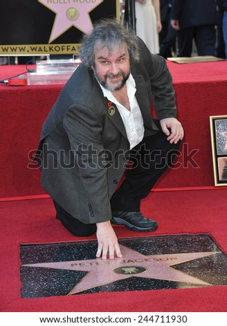 LOS ANGELES, CA - DECEMBER 8, 2014: Director Peter Jackson on Hollywood Blvd where he was honored with the 2,538th star on the Hollywood Walk of Fame.  - stock photo