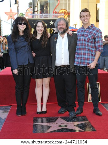LOS ANGELES, CA - DECEMBER 8, 2014: Director Peter Jackson & wife Fran Walsh & children on Hollywood Blvd where he was honored with the 2,538th star on the Hollywood Walk of Fame.  - stock photo