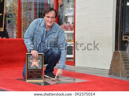 LOS ANGELES, CA - DECEMBER 21, 2015: Director Quentin Tarantino outside the TCL Chinese Theatre on Hollywood Boulevard where he was honored with the 2,569th star on the Hollywood Walk of Fame - stock photo