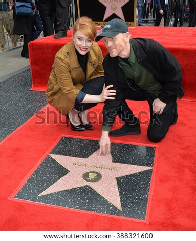 LOS ANGELES, CA - DECEMBER 10, 2015: Director Ron Howard & daughter actress Bryce Dallas Howard on Hollywood Boulevard where he was honored with the 2,568th star on the Hollywood Walk of Fame. - stock photo