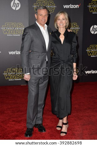 """LOS ANGELES, CA - DECEMBER 14, 2015: Disney boss Robert Iger & wife Willow Bay at the world premiere of """"Star Wars: The Force Awakens"""" on Hollywood Boulevard - stock photo"""
