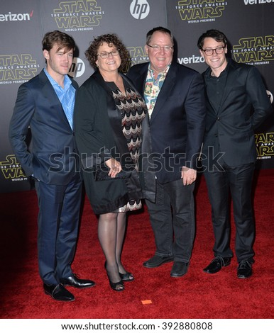 """LOS ANGELES, CA - DECEMBER 14, 2015: Disney-Pixar boss John Lasseter & wife & sons at the world premiere of """"Star Wars: The Force Awakens"""" on Hollywood Boulevard - stock photo"""