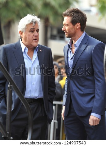 LOS ANGELES, CA - DECEMBER 13, 2012: Hugh Jackman & Jay Leno (left) on Hollywood Blvd where Jackman was honored with the 2,487th star on the Hollywood Walk of Fame. - stock photo