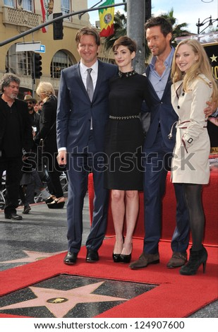 LOS ANGELES, CA - DECEMBER 13, 2012: Hugh Jackman & Les Miserable co-stars Anne Hathaway, Amanda Seyfried & director Tom Hooper. Jackman was honored with the 2,487th star on the Hollywood Walk of Fame - stock photo