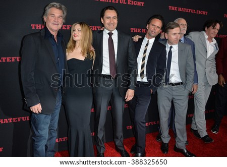 "LOS ANGELES, CA - DECEMBER 7, 2015: Kurt Russell (left), Jennifer Jason Leigh, Demian Bishir, Walton Goggins, Tim Roth & Michael Madsen at the premiere of ""The Hateful Eight"" at the Cinerama Dome - stock photo"