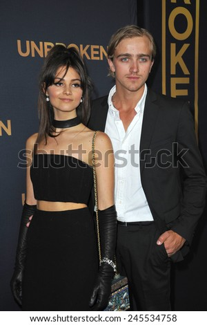 """LOS ANGELES, CA - DECEMBER 15, 2014: Louis McIntosh & Sophie Dalah at the Los Angeles premiere of their movie """"Unbroken"""" at the Dolby Theatre, Hollywood.  - stock photo"""