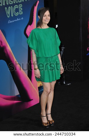 """LOS ANGELES, CA - DECEMBER 10, 2014: Michelle Sinclair at the Los Angeles premiere of her movie """"Inherent Vice"""" at the TCL Chinese Theatre, Hollywood.  - stock photo"""