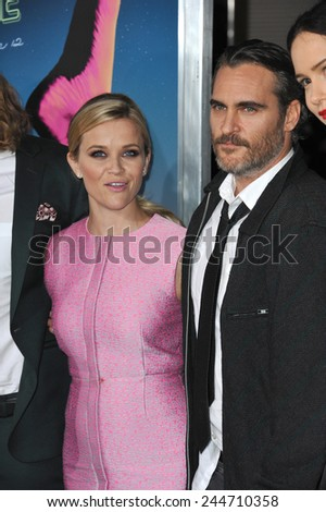 "LOS ANGELES, CA - DECEMBER 10, 2014: Reese Witherspoon & Joaquin Phoenix at the Los Angeles premiere of their movie ""Inherent Vice"" at the TCL Chinese Theatre, Hollywood."