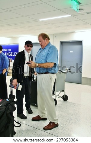 LOS ANGELES CA: Espn sportscaster Chris Berman at LAX arriving to Los Angeles to attend the Espy's being held at the Microsoft (formerly the Nokia) Theatre July 15, 2015. - stock photo