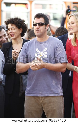 LOS ANGELES, CA - FEB 22: Adam Sandler at a ceremony where Jennifer Aniston is honored with a star on the Hollywood Walk of Fame on February 22, 2012 in Los Angeles, California - stock photo