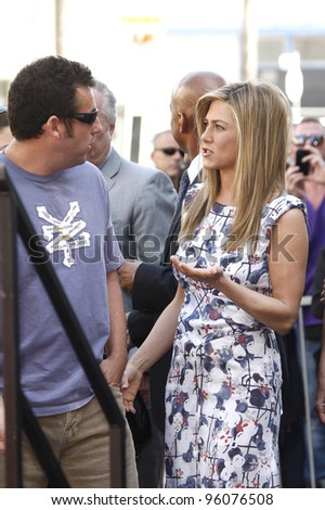 LOS ANGELES, CA - FEB 22: Jennifer Aniston; Adam Sandler at a ceremony where Jennifer Aniston is honored with a star on the Hollywood Walk of Fame on February 22, 2012 in Los Angeles, California - stock photo