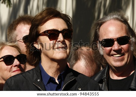 LOS ANGELES, CA - FEB 9: Paul McCartney; Neil Diamond at a ceremony where Paul McCartney is honored with a star on The Hollywood Walk Of Fame on February 9, 2012 in Los Angeles, California