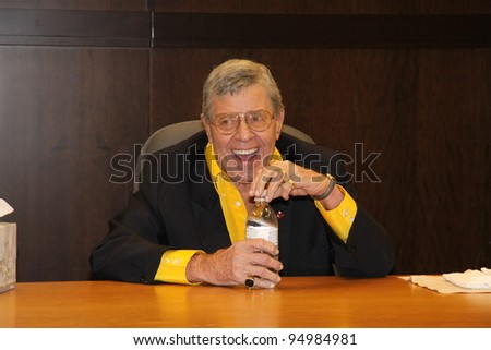 "LOS ANGELES, CA – FEBRUARY 8: Actor Jerry Lewis signs his new DVD, ""The Jazz Singer"" at Barnes and Nobles at the Grove on February 8, 2012 in Los Angeles, Ca. - stock photo"
