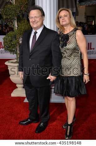 "LOS ANGELES, CA - FEBRUARY 1, 2016: Actor Wayne Knight & wife Clare De Chenu at the world premiere of his movie ""Hail Caesar!"" at the Regency Village Theatre, Westwood."