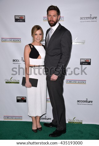 LOS ANGELES, CA - FEBRUARY 25, 2016: Actress Joanne Froggatt & husband James Cannon at the US-Ireland Alliance's 11th Annual Oscar Wilde pre-Academy Awards event honoring the Irish in Film.  - stock photo