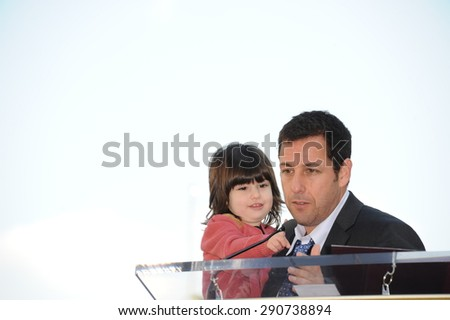 LOS ANGELES, CA - FEBRUARY 1, 2011: Adam Sandler & daughter on Hollywood Boulevard where he was honored with the 2,431st star on the Hollywood Walk of Fame. - stock photo