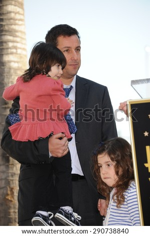 LOS ANGELES, CA - FEBRUARY 1, 2011: Adam Sandler & daughters on Hollywood Boulevard where he was honored with the 2,431st star on the Hollywood Walk of Fame. - stock photo