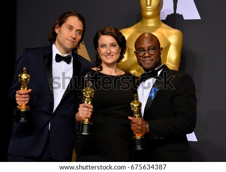 LOS ANGELES, CA - FEBRUARY 26, 2017: Adele Romanski, Jeremy Kleiner & Barry Jenkins in the photo room at the 89th Annual Academy Awards at Dolby Theatre, Los Angeles