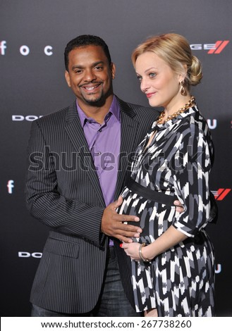 "LOS ANGELES, CA - FEBRUARY 24, 2015: Alfonso Ribeiro & wife Angela at the Los Angeles premiere of ""Focus"" at the TCL Chinese Theatre, Hollywood.  - stock photo"