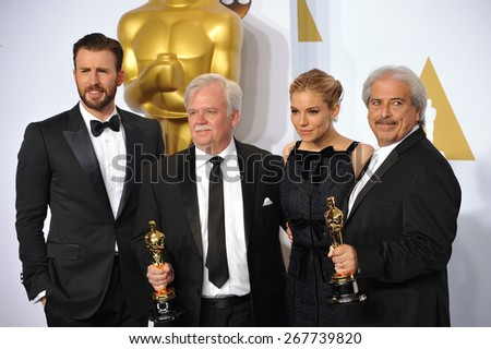 LOS ANGELES, CA - FEBRUARY 22, 2015: Chris Evans & Alan Robert Murray & Bub Asman & Sienna Miller at the 87th Annual Academy Awards at the Dolby Theatre, Hollywood.