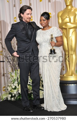 LOS ANGELES, CA - FEBRUARY 26, 2012: Christian Bale & Octavia Spencer, winner of Best Supporting Actress for The Help, at the 82nd Academy Awards at the Hollywood & Highland Theatre, Hollywood.  - stock photo