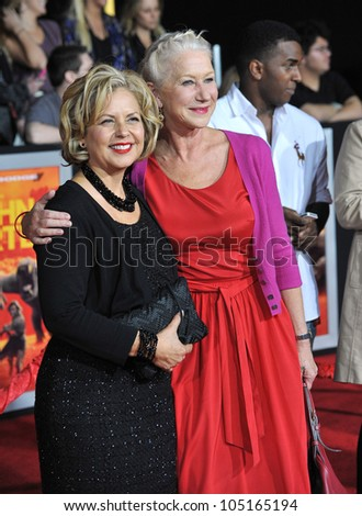 "LOS ANGELES, CA - FEBRUARY 22, 2012: Dame Helen Mirren & costume designer Mayes Rubeo (left) at the world premiere of ""John Carter"" at the Regal Cinemas L.A. Live. February 22, 2012  Los Angeles, CA"