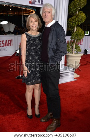 "LOS ANGELES, CA - FEBRUARY 1, 2016: Director of Photography Roger Deakins & Isabella James Purefoy Ellis at the world premiere of ""Hail Caesar!"" at the Regency Village Theatre, Westwood."
