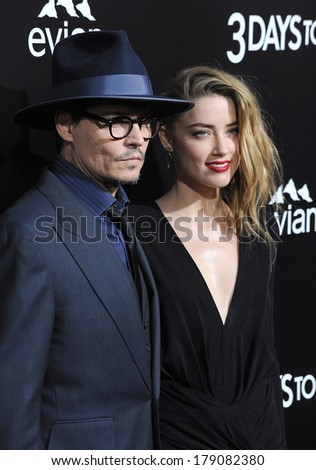 "LOS ANGELES, CA - FEBRUARY 12, 2014: Johnny Depp & fiance Amber Heard at the US premiere of her movie ""3 Days To Kill"" at the Arclight Theatre, Hollywood.  - stock photo"