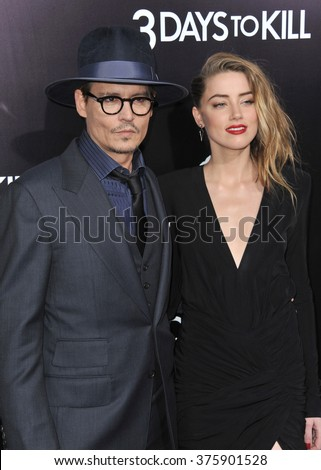 """LOS ANGELES, CA - FEBRUARY 12, 2014: Johnny Depp & fiancee Amber Heard at the US premiere of her movie """"3 Days To Kill"""" at the Arclight Theatre, Hollywood.  - stock photo"""
