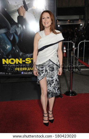"""LOS ANGELES, CA - FEBRUARY 24, 2014: Julianne Moore at the world premiere of her movie """"Non-Stop"""" at the Regency Village Theatre, Westwood.  - stock photo"""