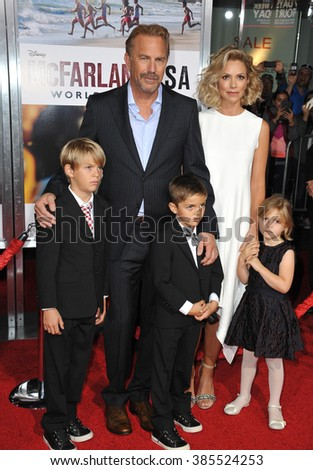 "LOS ANGELES, CA - FEBRUARY 9, 2015: Kevin Costner & wife Christine Baumgartner & children at the world premiere of his movie ""McFarland USA"" at the El Capitan Theatre, Hollywood."